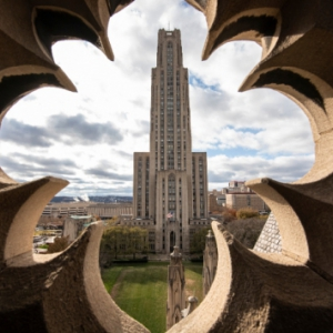 View of the Cathedral of Learning from an architectural cutout at the top of Heinz Chapel