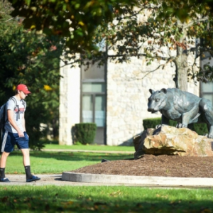 Student walking on Pitt–Johnstown campus