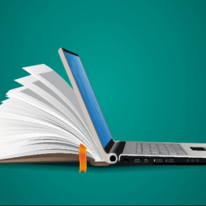 stock photo of a laptop and an open book