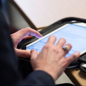person using a tablet