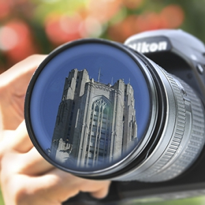 The Cathedral of Learning reflected in a camera lens.