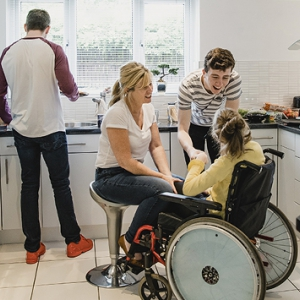 A woman in a wheelchair in a kitchen