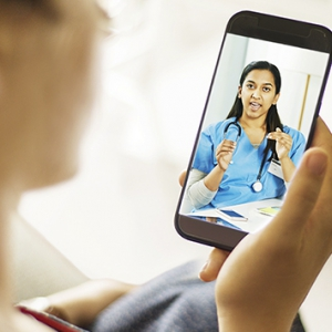 Person having a virtual consult with a physician on a smartphone
