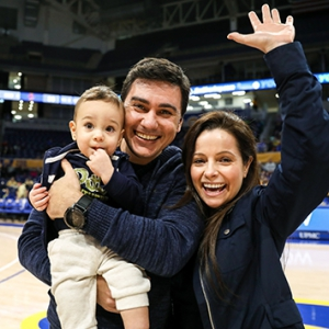 Winning baby race crawler Noah Domingos Santos came to his first Chancellor's Friends, Family and Neighbors Day women's basketball game with parents Diogo Francisco Santos and Hatalita Domingos.