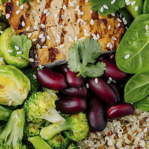 Various foods, including Brussels sprouts, spinach and grains plated together