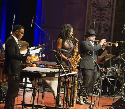 Musicians on stage playing jazz music.