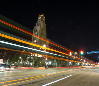Cathedral of Learning at night with traffic lights