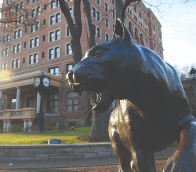 A statue of a panther in front of the William Pitt Union